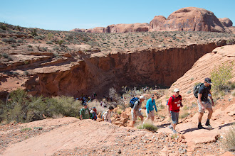 Photo: The group continues to hike up among the rocks.
