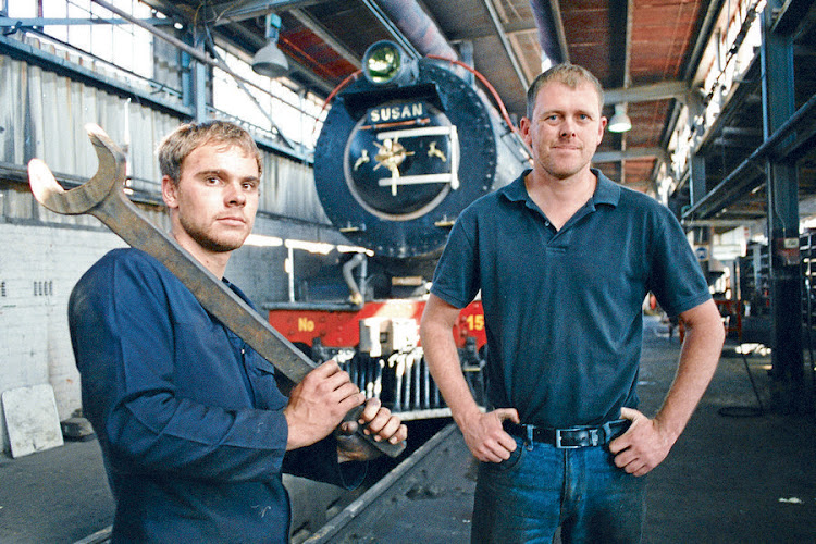 Steam engine fireman Jandre Gordon and Reefsteamers chief engineer Shaun Ackerman with their iron horse, class 12AR