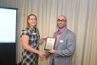 Photo: Abbey presenting award to Georges for outstanding ASHRAE Research promotion for 2014-2015