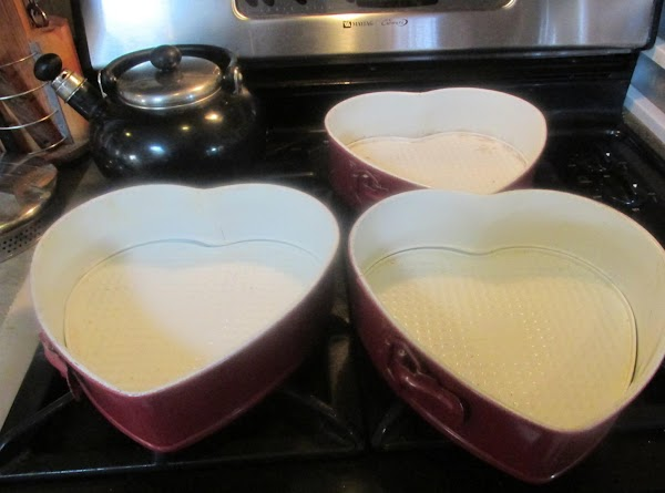 Preheat oven to 350 degrees F. Spray or grease 3 -8 inch cake pans,...