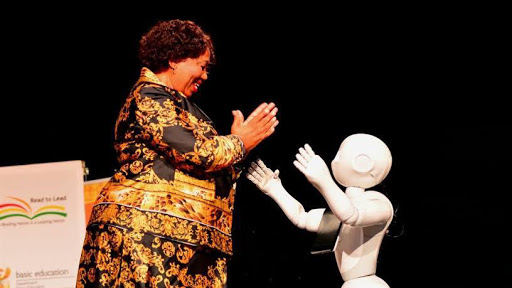 Basic education minister Angie Motshekga with Pepper the robot.