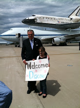 "Photo: Transportation Secretary Ray La Hood with Claire Jonas,10,of Herndon, Va. Claire saw the shuttle launch for it's last time, so it was extra special to watch it land at Dulles: ""It was really cool. It was so big.""  Photo by: Malia Rulon"
