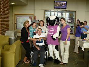 Photo: Speech Therapy graduate students, Miss Cow w/ adult Speech Therapist patient and wife.