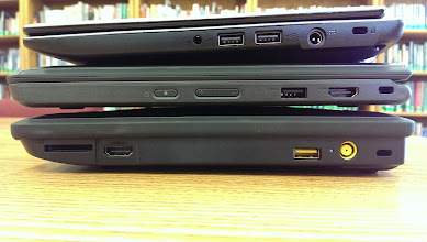 Photo: This picture shows the Acer C710 on top for comparison. The 11e is just about as thick as the battery end of the Acer, though the C710 tapers down at the other end.   Again, notice the significant dome of the x131e LCD cover.