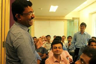 Photo: Self Advocate Thomas Libin Jacob, who has a hearing impairment, addressing the employees of L'Oreal, Powai (Mumbai)