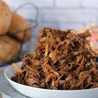 Slow Cooker Pulled Pork Sandwiches with Zesty Slaw.