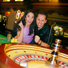 Photo: ca. 2002, Las Vegas, Nevada, USA --- Man and Woman Playing Roulette --- Image by © Royalty-Free/Corbis