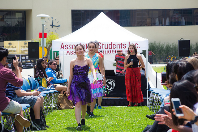 Models walking down the runway during the Revamp: Sustainable Fashion Show at University Park.