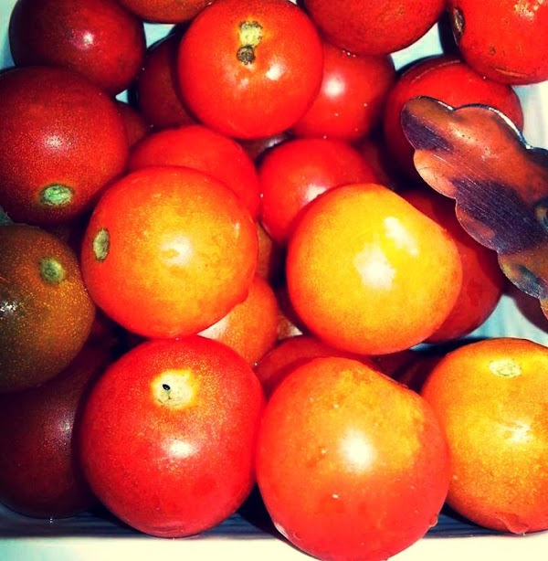 Wash and pat dry the cherry tomatoes.   You can leave them whole or...