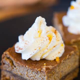 Gingerbread Cheesecake Bars with Orange Whipped Cream.