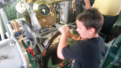 Photo: Ethan turning the rudder of the Intrepid