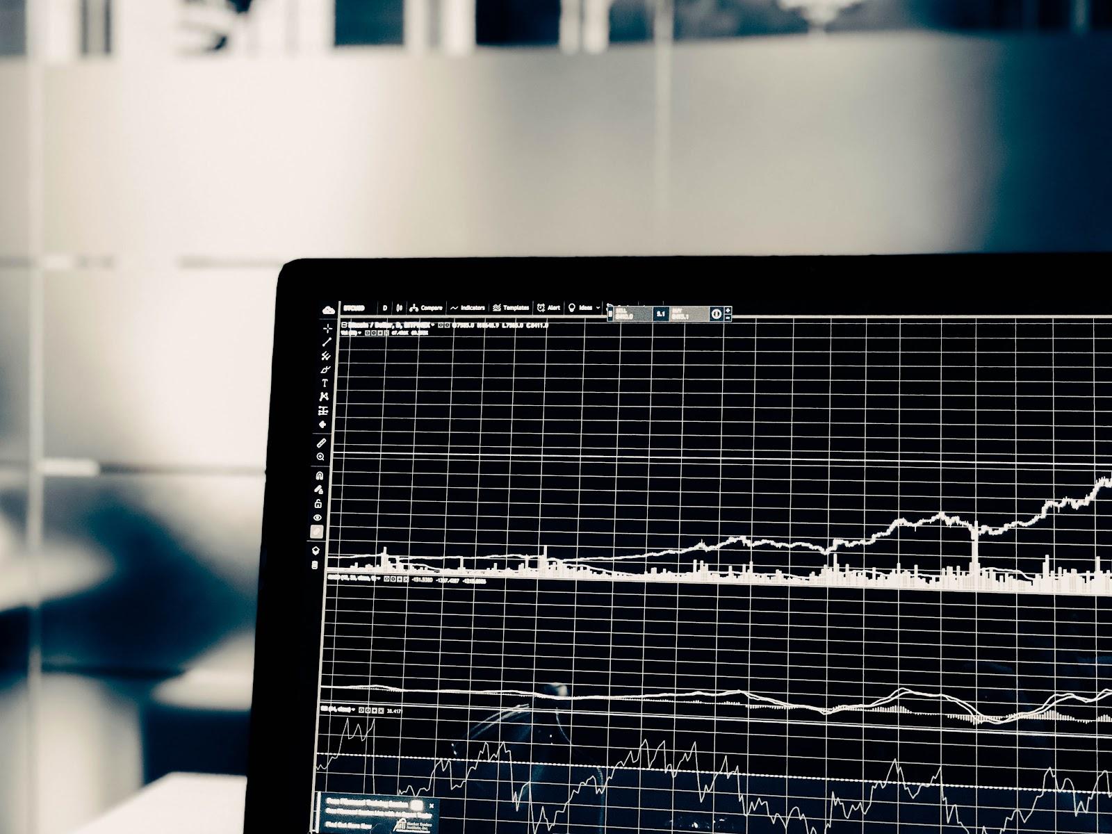 Black computer screen displaying graphs