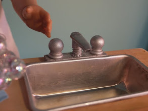 Photo: The sink is a mini bread pan.  The faucet is a hand lotion pump and the knobs are wooden finials.