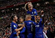 Chelsea players celebrate after scoring a goal.
