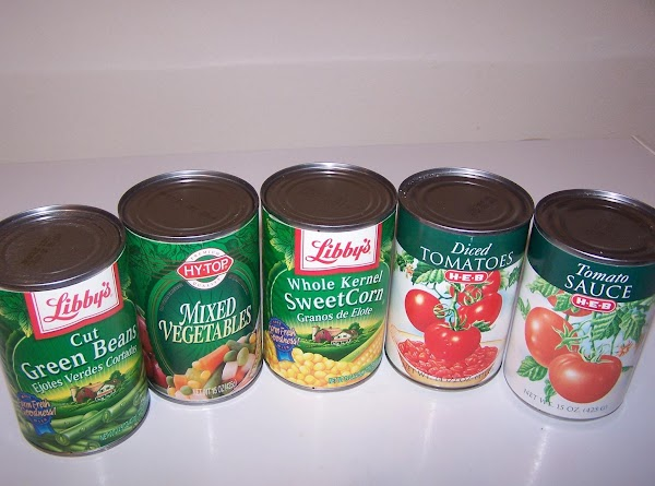 Open cans of vegetables and pour in large heavy saucepan. Add tomatoes and tomato...