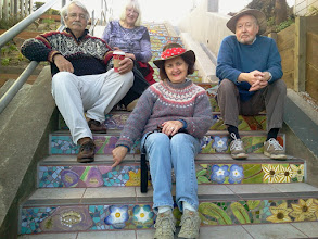 Photo: Members of the Magary family near their family tile on the Hidden Garden Steps (16th Avenue, between Kirkham and Lawton streets in San Francisco's Inner Sunset District); the Steps project has quickly become a place where neighbors meet, eat, talk, and dream about additional ways to strengthen community ties in San Francisco's Inner Sunset District.   For more information about the Steps, please visit our website (http://hiddengardensteps.org), view links about the project from our Scoopit! site (http://www.scoop.it/t/hidden-garden-steps), or follow our social media presence on Twitter (https://twitter.com/GardenSteps), Facebook (https://www.facebook.com/pages/Hidden-Garden-Steps/288064457924739) and many others.