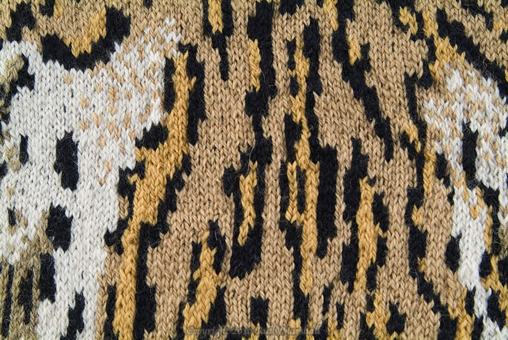 """Photo: #3 Ocelot  2010   46"""" x 26""""  (116cm x 66cm) Hand knitted textile. Interpretation of ocelot based on study of actual pelt at American Museum of Natural History. Female - New York Zoo, 1921. Yarn, string, sticks. (C) Ruth Marshall, 2010."""
