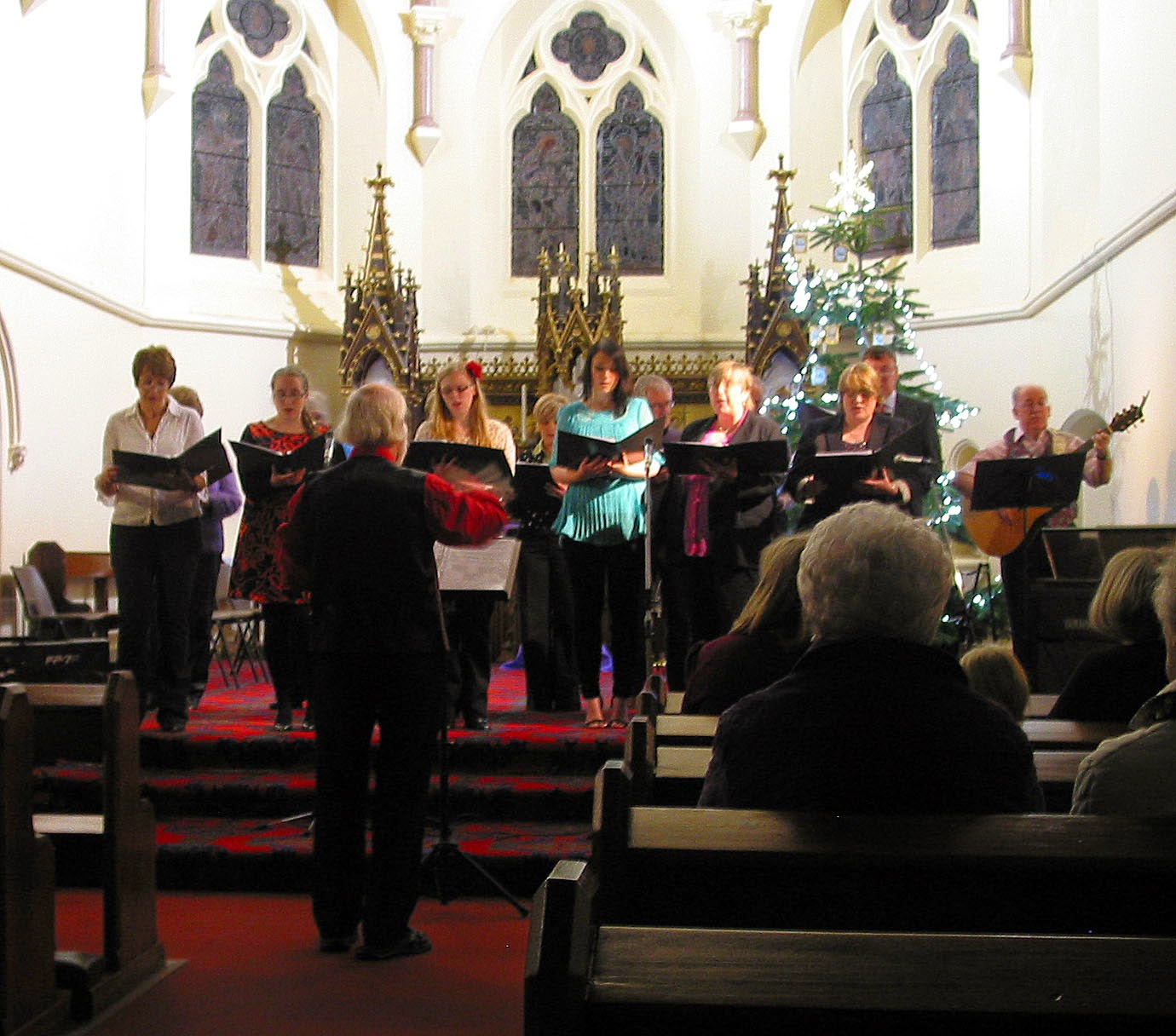 Photo: The Choir Bill Barr, Jessica Coyle, Joanne Coyle, Shannon Coyle, Dan Devlin, Leo Franey (Choir Master), Sarah Franey, Sheila Franey, Maureen Hayley, Eileen Horan, Tony Long, Marian McGowan, Sheila Vasey and Karin Weetman conducted by John Childs Performed in three sets O Come All Ye Faithful, Rejoice Rejoice, Coventry Carol, The Little Drummer Boy / Peace On Earth, Carol of the Bells, Deck the Halls, Gaudete, Stille Nacht, Sleigh Ride, White Christmas, Hark! the Herald Angels Sing, and Have Yourself a Merry Little Christmas