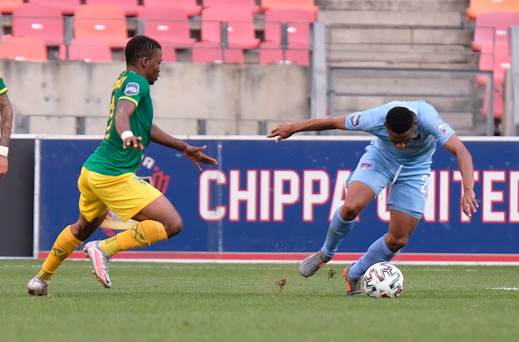 Thabiso Lebitso of Chippa United (R) and Lindokuhle Mtshali of Golden Arrows (R) tussle for the ball during the match.