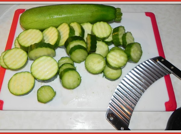 Slice the Zucchini into a medium thick slices and then place them on a...