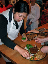 """Photo: Lillian filling a """"chaploo"""" leaf with various tidbits"""