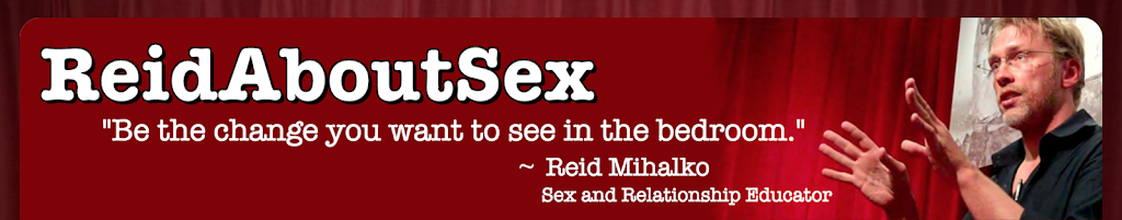 "ReidAboutSex.com banner of Reid, a blonde man wearing glasses and a black shirt teaching against a red curtain background with the text, ""ReidAbotuSex, Be the change you want to see in the bedroom, Reid Mihalko, sex and relationship educator in white letters"
