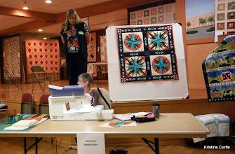 Photo: Sharon Rozycki demonstrating machine embroidery.