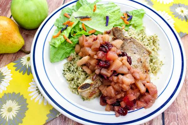 Apple And Pear Chutney Spooned Over Pork Chops.