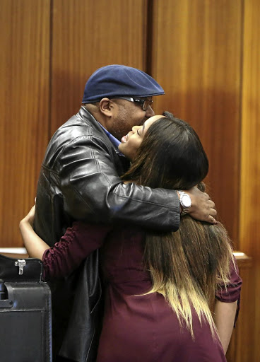 Cheryl Zondi with her father Mxolisi Zondi in court during her testimony against pastor Timothy Omotoso in the PE high court.