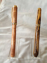 Photo: Closed-end Baron Rollerballs.  Cherry on the left and Bocote on the right.