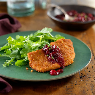 Ginger-Crusted Pork Cutlets with a Cinnamon Orange-Cranberry Chutney and Wilted Arugula.