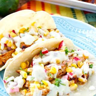 Chipotle Chicken Tacos with Avocado Crema and Corn-Radish Salsa.