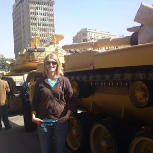Expat woman in cairo egypt during the egyptian revolution with a tank