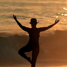 Yoga at sunset by Cristobal Garciaferro Rubio - People Fine Art ( sand, sunset, waves, lady, beauty, yoga )