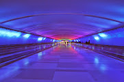 Photo: The underground walkway between McNamara Terminal Concourse A and Concourses B/C features a stunning light and sound experience, including an artistic glass installation by Fox Fire Glass of Pontiac, MI, and music by Mills/James Productions of Columbus, OH. CREDIT: Wayne County Airport Authority/Vito Palmisano.