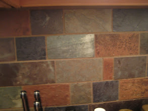 Photo: Some of the tiles used as the backsplash came from the old roof.