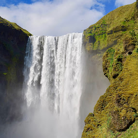 Roaring Skogafoss by Santford Overton - Landscapes Waterscapes ( landscapes, sky, mountains, waterscapes, light, cliff, waterfall, river, clouds, water, photography )