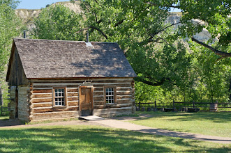 Photo: The Maltese Cross Cabin, Theodore Roosevelt's original ranch cabin, is adjacent to the South Unit Visitor Center. The Maltese Cross Ranch cabin was originally located about seven miles south of Medora in the wooded bottomlands of the Little Missouri River.