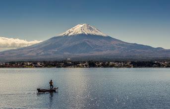 Photo: A man fishes in Lake Kawaguchiko at the base of Mt Fuji, Japan