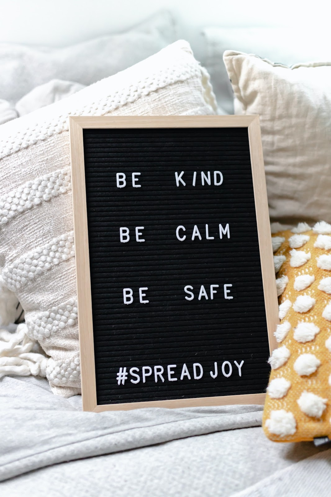 Letter board with the words be kind, be calm, be safe, spread joy