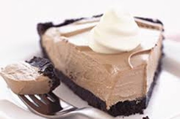 COOL 'N CREAMY CHOCOLATE PIE Place milk in a large mixing bowl. Whisk in the...
