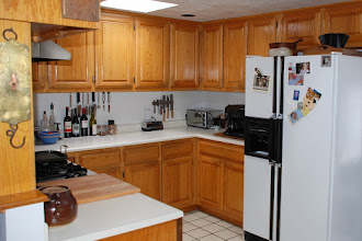 Photo: Before remodel - oak cabinets and tile floor.