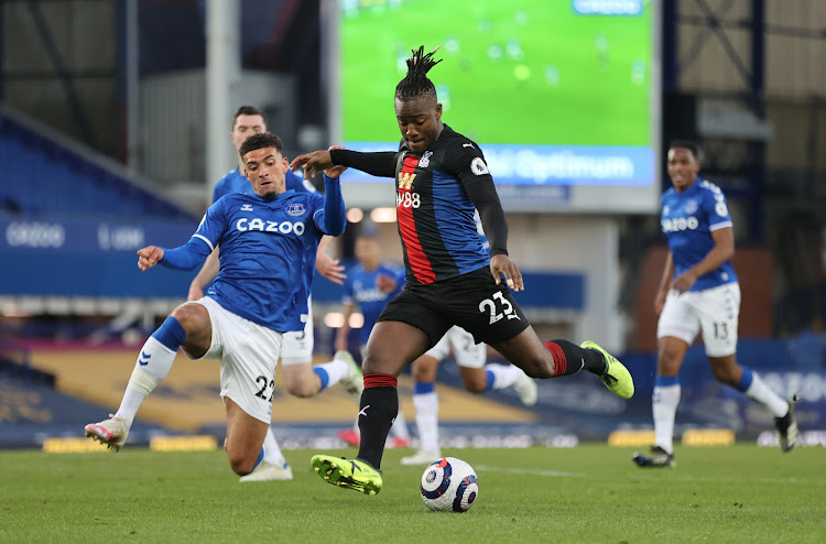 Crystal Palace's Michy Batshuayi in action with Everton's Ben Godfrey