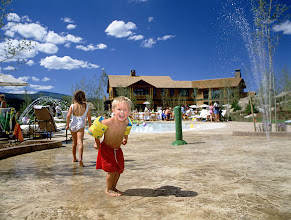 Photo: Playing in the water feature by the baby pool