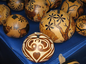 Photo: Decorated gourds are still popular and are imported and shipped all around the world.  Staining, painting and burning are all decorative techniques that go back thousands of years.   These are from South America and were for sale at Jackalope in Sante Fe, New Mexico (import, export, 'stuff').    Buffalo and guanaco along with birds and deer are illustrated in some of these gourds.