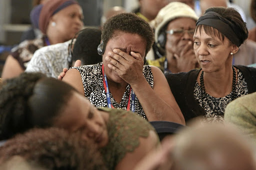 FILE PHOTO: Family members become emotional as the admin officer of the Mamelodi Hospital Mortuary, Daniel Buda, describes the condition of a body during the  Life Esidimeni hearings in Parktown, Johannesburg.
