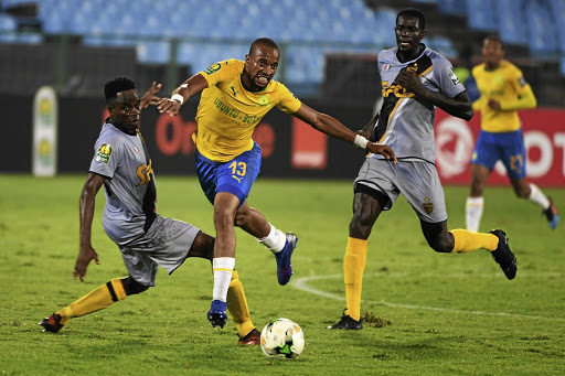 Tiyani Mabunda of Mamelodi Sundowns is tackled by Wonlo Coulibaly of Asec Mimosas./ Gallo Images / Lee Warren