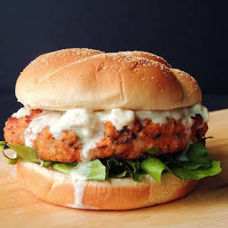 Buffalo Chicken Burgers with Creamy Blue Cheese Sauce.