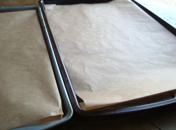 Preheat oven to 450 degrees F.  Line 2 baking sheets with parchament paper...