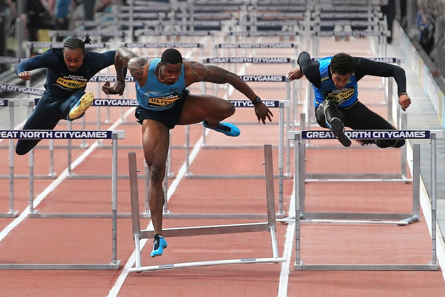 Pushing Through by Ron Russell - Sports & Fitness Running ( hurdling, speed, racing, male, wallop, running, bang, crash )